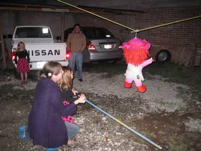 And there it is, folks!!  The first pinata Molly has EVER hit!  We'll pretend that it wasn't me who was actually doing most of the hitting :)