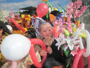 The girls' school put on a Spring parade last week.  Here's Lauryn on her float.