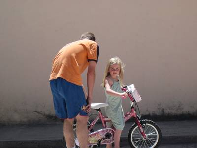 Lauryn begged Chris to take off her training wheels yesterday.