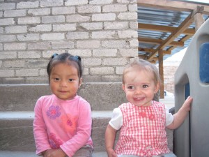 My neighbor's little girl and my baby on the back steps.