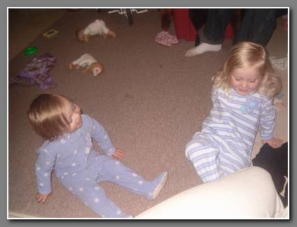 Playing around on the floor in their jammies.