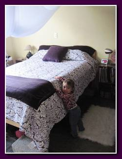 It's amazing how much of a difference a simple bedspread, a throw and a pillow makes!