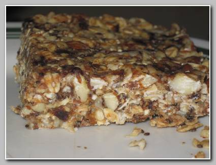 I've been making huge batches of granola bars and muffins for the girls to take to school for their snack time.  I've found two recipes that are great and this one is the protien bar from Passionate Homemaking and it's full of nuts and prunes and a little honey.  This is my other favorite granola bar recipe.